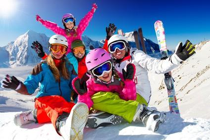 Ski, snow, sun and winter fun - happy family ski team